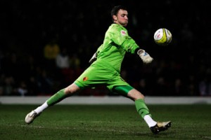 Watford-goalkeeper-Scott-Loach-takes-a-goal-kick-during-the-Coca-Cola-Championship-match-between-Watford-and-Swansea-City-at-Vicarage-Road-on-February-17-2009-in-Watford-England